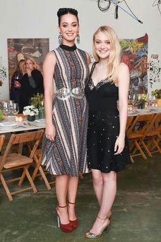 Katy Perry and Dakota Fanning at the Rodarte x & Other Stories dinner hosted by Dakota last evening at the studio of Elliott Hundley.