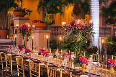 Guest tables styled with soft lighting set the mood for love and romance.   A Halloween Beach Wedding in Naples, Florida. - Brides