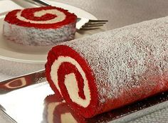 Red Velvet Cake Roll  -----  Homemade goodness all rolled up!  Thin Red Velvet Cake layer filled with cream cheese frosting then rolled up.