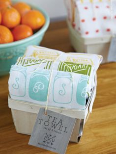 Made of cotton and sporting colorful graphics, give this Tea Towel Set ($38 for three) to a hip homemaker. #hostess #gift