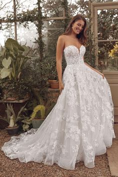 This sweetheart ball gown is vintage inspired with a modern twist. Allover embroidered and Chantilly lace detail the gown. The illusion bodice features a small plunge and the hem is finished with a horsehair trim.