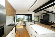Timber tones add richness to kitchen » Archipro