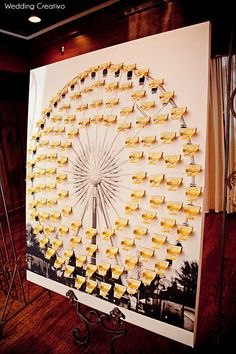 giant Ferris wheel board for table cards, this one made by bride's father
