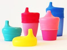 """SipSnap lids come with straw holes or with spouts, like these. Instant """"sippy cups"""" for your LOs."""