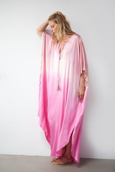 A caftan is a perfect addition to any women's wardrobe. It can be worn day into night, as a stunning swimsuit cover-up at the beach, as well as a glamorous