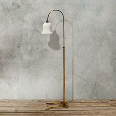 With an antique brass base and crisp, clean white shade, the Marla Floor Lamp adds sophistication to any décor Reading Lamp, Lamp, Desk Lamp, Floor Lamp, Decor Design, Arhaus Furniture, Reading Lamp Floor, Contemporary Floor Lamps, Dream Living Rooms