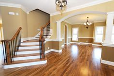 I love the stair entry and the color of the wood floors and the open space