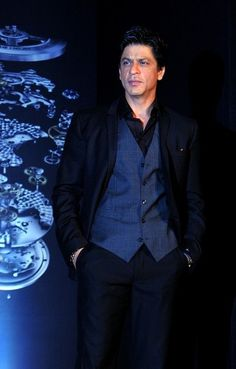 Indian Bollywood film actor and brand ambassador Shah Rukh Khan poses during the launch of the latest 'TAG Heuer' Carrera 1887 Elegance watch series in Mumbai on August 6, 2012.