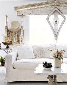 love the marble table with the white sofa