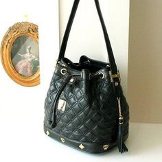 MCM Handbags - Vintage MCM Quilted Bucket Bag on Poshmark