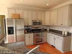 Traditional Kitchen with Complex granite counters, L-shaped, Stonemark Granite Baltic Brown Granite, Subway Tile