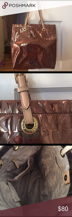 Michael Kors bag - brown Adorable MK tote bag, deep enough to use as a school bag! Reflective brown with MK logo and leather straps. Purchased at Nordstrom. Lots of pockets inside and pocket for your phone! MICHAEL Michael Kors Bags Totes