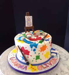 Artist cake, with easel, paint tubes etc. Paintings were ...