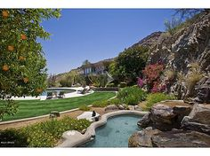 10 ACRE ESTATE-FLAT GROUNDS!HIGH ON THE MTN! Electronic gates and long driveway past speciman plantings,a 28 tree citrus grove and breathtaking views of McDowells,Superstitions,4 Peaks and rock outcroppings! Sweeping mountain and city light views pour into floor-to-ceiling windows of this fabulous 13,000 s.f. home on large FLAT front and rear grounds high on Mummy Mtn! Entertain in a 55 ft. #zillow