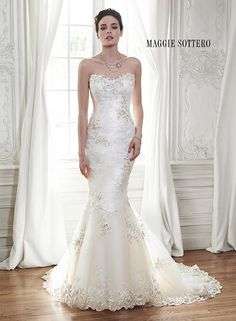 Lace and tulle fit and flare wedding dress, complete with three-dimensional lace…