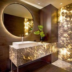 Beautiful bathroom featuring backlit Onyx Black Cloud.