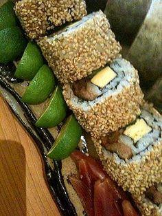 Sushi roll (futo-maki) with sesame coating.   https://www.facebook.com/thesamuraigourmet.jp