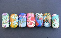 polymer clay focal beads.  http://flickrhivemind.net/Tags/focalbeads