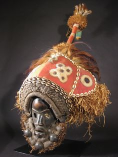 Africa | Dan mask from the Ivory Coast. Wood, feathers, wire, cowrie shells, cloth and plant fiber. | This would be a Deangle stilt dancer's mask. | ca. post 1940.
