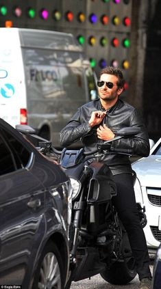 Bradley Cooper rides the streets of London during a photo shoot for Adam Jones. via MailOnline