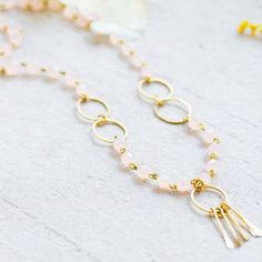Pink Blush Bead Necklace, Blush Bead pendant necklace, Paddle Necklace A Mixed Media Necklace made with pale blush beads, hand forged brass hoops round) and a bottom hoop with long brass paddles. The necklace is shipped in a gift box. Beaded Necklace, Beaded Bracelets, Pendant Necklace, Necklaces, Wire Jewelry, Unique Jewelry, Jewelry Ideas, Blush Pink, Beads