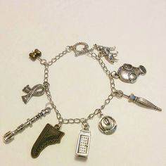 DR.Who fandom charm bracelet,nineth doctor,tardis,sonic screw driver,dalek,cosplay,phone booth by Blackrose37 on Etsy