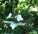 Holland Hill's number one selling ivy hummer feeder. Perfect for gift giving. It has 3 tubes, 3 beautiful verdigris copper ivy leaves and a hook below to hang flowering baskets or more.  #hummingbirdfeeder #gardengifts
