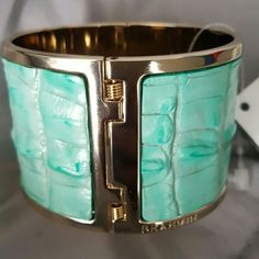 """Brahmin Cuff Bracelet The cuff bracelet is new and the tag is still on. It is 100% leather in the color mint. The gold detailing is inside ans around the rim of the bracelet and at the hinge. I put it on so you can see how it fits and how much room it takes up on the wrist. The cute grey """"Brahmin"""" shopping bag is included. Brahmin Jewelry Bracelets"""