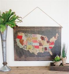 Reminiscent of vintage schoolhouse map scrolls, this canvas banner has a country decor twist. The USA Patchwork Print Map Banner gives each state its own colorful quilt swatch. The printed reproduction map has a time-worn, aged appearance, inspired by antique shop finds. The scroll banner features wooden dowel rods on the top and bottom, just like old schoolroom maps. Brighten your farmhouse with this unique wall map.