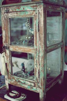 Could be used either in the house for display or as a small greenhouse. Probably not too difficult to make from small glass windows...or old cabinet doors (if you can take out any solid wood panels and replace with glass.)