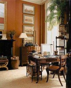 traditional living room with burnt sienna walls - G. P. Schafer Architect, PLLC - gpschafer.com