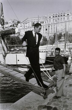 Errol Flynn, coming ashore in Monaco, November 1950 Errol Flynn, Hollywood Cinema, Classic Hollywood, Monaco, Sean Flynn, Sinbad The Sailor, Old Paris, Paris Match, Handsome Actors
