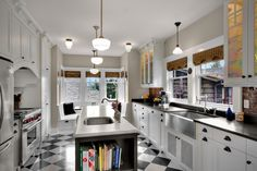 Kitchen resembles our layout (floor, double sink window, banquet at the back or doors, island) Phinney Residence kitchen traditional kitchen