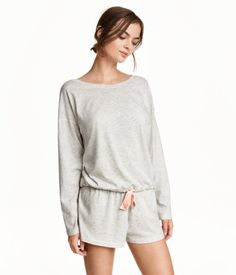 Pajama set in soft, cotton-blend jersey. Wide-cut top with dropped shoulders, long sleeves, and drawstring at hem. Short shorts with elasticized waistband. | H&M Lingerie