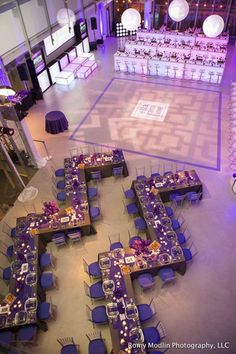 Glamorous purple wedding reception with uniquely designed seating; Featured Photographer: Romy Modlin Photography llc
