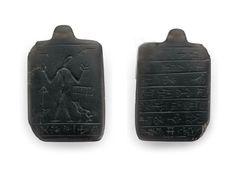 A Neo-Assyrian obsidian lamashtu amulet, circa 8th-7th century B.C.
