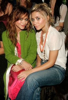 Mary-Kate and Ashley Olsen begin attending New York Fashion Week, sporting clearly defined and independent styles.