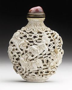 Snuff Bottle (Biyanhu) with Nine Playing Lions, China, Late Qing dynasty, about 1800-1911, Molded soft-paste porcelain with reticulated design, with rose quartz mounted stopper