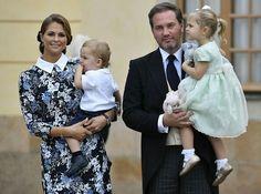 Princess Madeleine of Sweden holding Prince Nicolas, Chris O'Neill holding Princess Leonor at the christening of Prince Alexander. Stockholm. September 9 2016