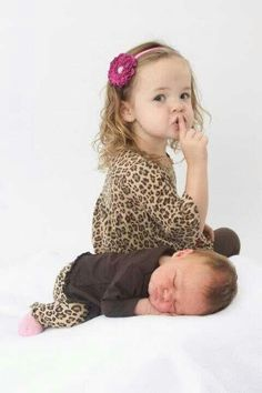 Sibling picture idea :) minus the animal print, lol.