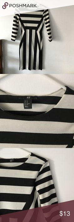 """H&M bold, black & white bodycon dress H&M bold stripe, fitted dress. The line patterns on this dress are designed to flatter the figure. I am 5'2"""" and this hits my knee. Only worn once! This Dress has some stretch in the material. H&M Dresses Midi"""