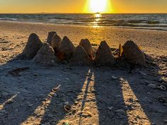 Yesterday's sand castle greets the sun.