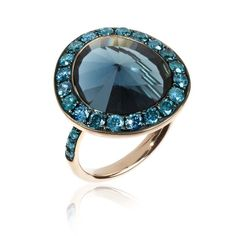 Annoushka Dusty Diamonds rose gold ring with blue diamonds and a London blue topaz.