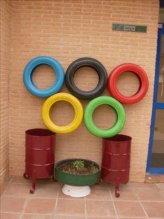 Deporte Ecológico. Neumáticos pintados con los colores de los 5 continentes, imitando el logo de los Juegos Olímpicos