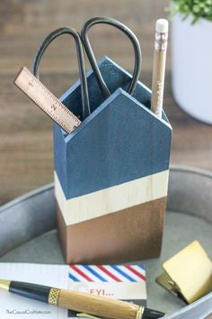 Create a contemporary Metallic and Wood Pencil Holder using a pre-made wooden block and metallic paint.