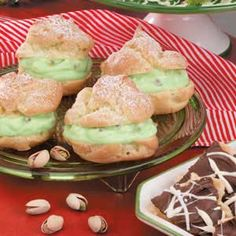 Pistachio Cream Puffs - Instant pudding mix speeds up these delightful desserts from Helen Youngers of Kingman, Kansas. With a pretty green filling and a dusting of confectioners' sugar, the luscious puffs make festive and impressive dinner finales during the Christmas season.