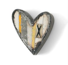 Small Yellow Heart with X by Anthony Hansen. Hansen transforms automotive sheet metal into patchwork hearts, viewing each scratch and spot of rust as a treasure of visual texture. Ready to hang. Each heart is created from a unique set of reclaimed materials and will vary greatly.