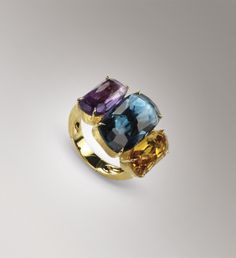 Marco Bicego ring.  This jewel mounts cushion cut, irregular and faceted Topaz, Amethyst and Yellow Quartz stones.