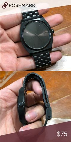 Black Nixon time teller watch Barely use Nixon time teller watch. It's unisex. Needs new battery Nixon Accessories Watches