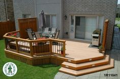 Front view of a large, low, single level deck with privacy screens.